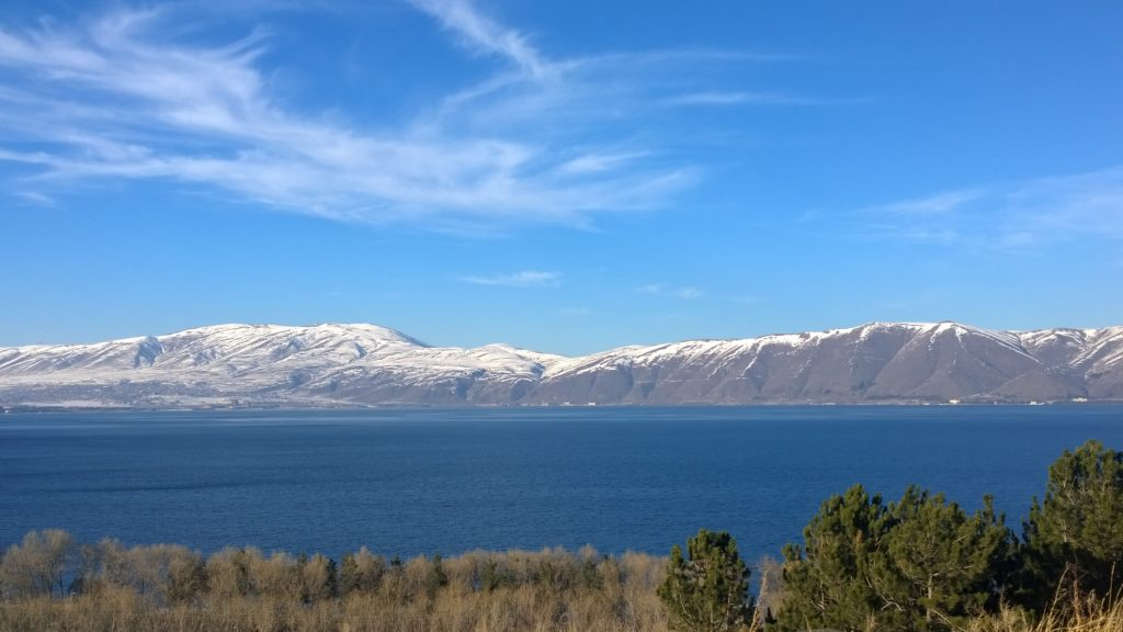 Lake Sevan under the clear, blue sky