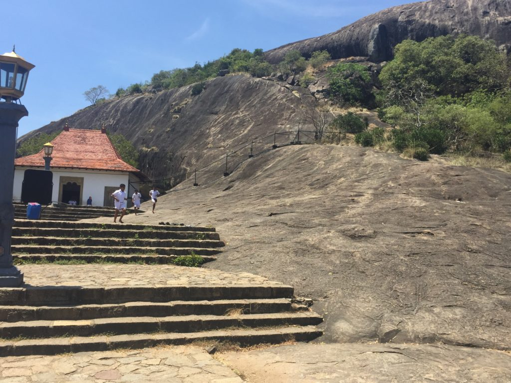 Beneath the big rock are the Dambulla Caves