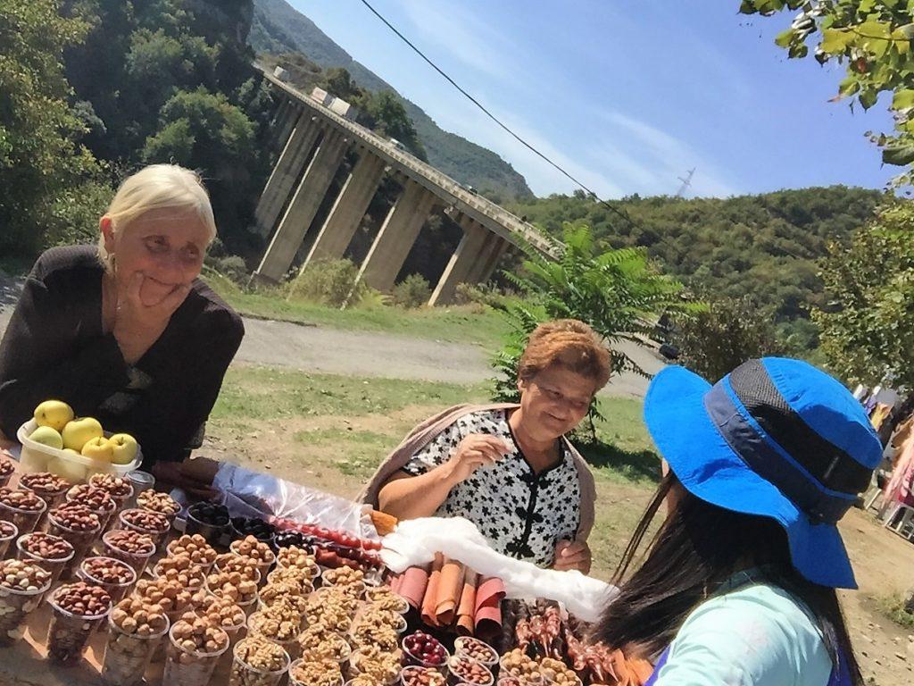 Buying fruits outside Ananuri Castle