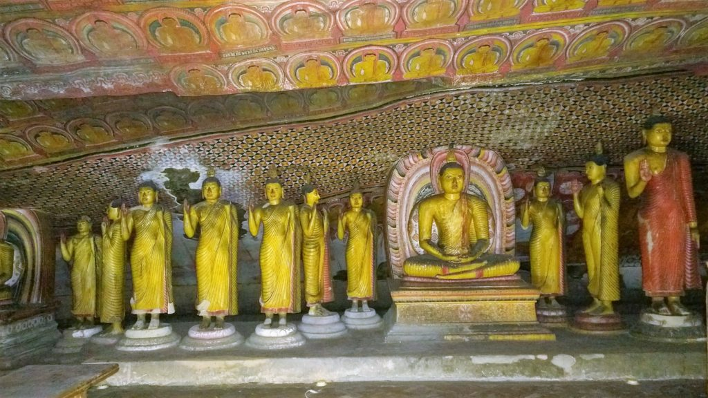 The standing Buddhas and a sitting Buddha